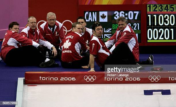 The curling team from Canada rests half way through their match in the preliminary round of the men's curling between Canada and Great Britain during...