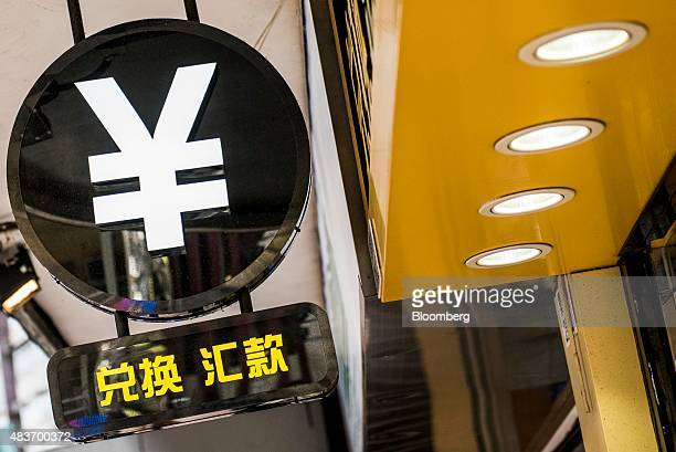 The currency symbol for the Chinese yuan is displayed at a currency exchange store in Hong Kong China on Wednesday Aug 12 2015 The yuan sank for a...