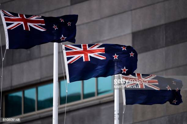 The current New Zealand flag flutters outside a Te Papa museum in Wellington on February 16 2016 In March this year New Zealanders will decide...