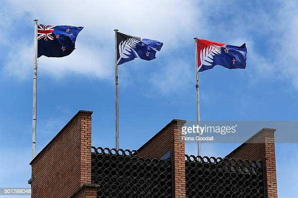 The current New Zealand flag the referendum winning blue and black Kyle Lockwood designed flag and the second placed red and blue flag fly on a...