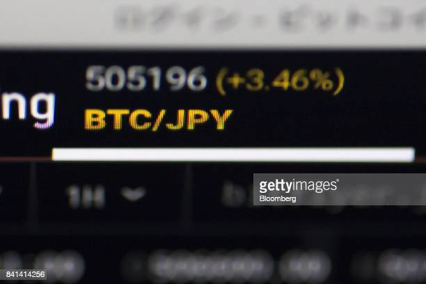 The current price of bitcoin against Japanese yen is displayed on a computer monitor via software for trading virtual currencies in Tokyo Japan on...