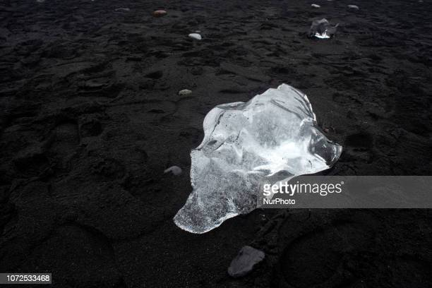 The currents drag chunks of ice to the volcanic sandy beach of Jökulsárlón in Iceland known as quotbeach of diamondsquot for this phenomenon The area...