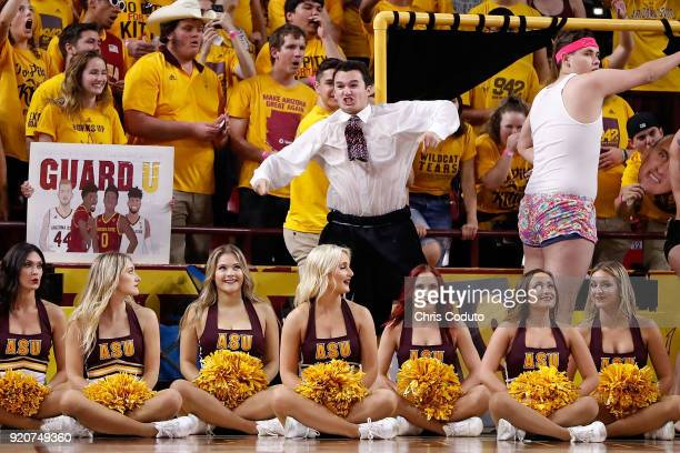 The 'Curtain of Distraction' performs during the second half of the college basketball game between the Arizona State Sun Devils and the Arizona...