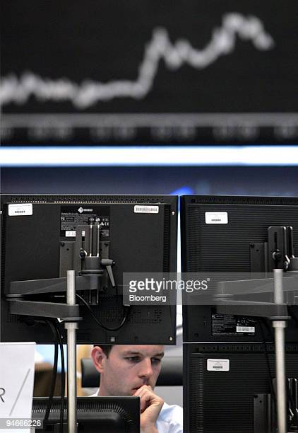 The curve of the DAX index is seen on the board as traders work at the Frankfurt Stock Exchange in Frankfurt, Germany, Wednesday, August 1, 2007....