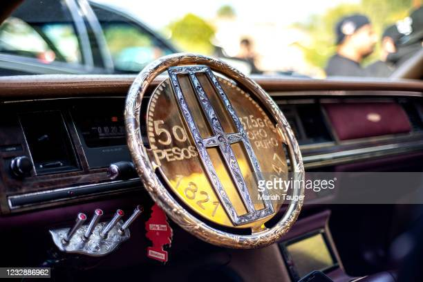 The custom gold plated steering wheel inside Joe Arevalos 1991 Lincoln Town Car.