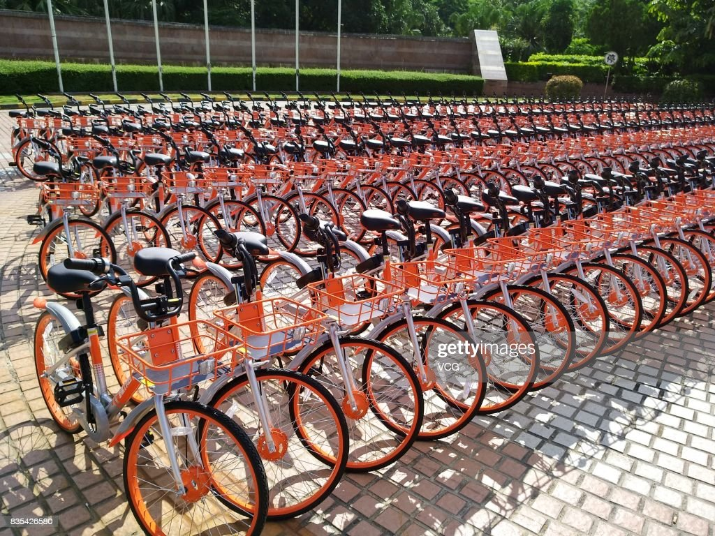 The customized shared bicycles with slogans that eulogize China are seen lined up on the street at Futian District on August 19, 2017 in Shenzhen, Guangdong Province of China. The bicycles with China-themed slogans belong to Chinese bike-sharing service Mobike.