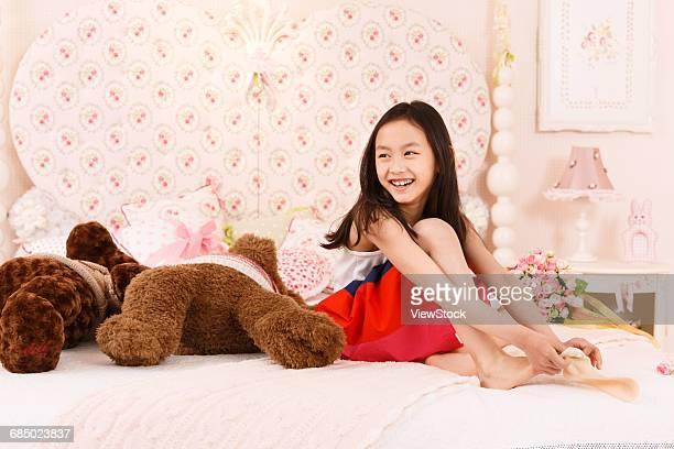 The cute little girl is wearing a sock