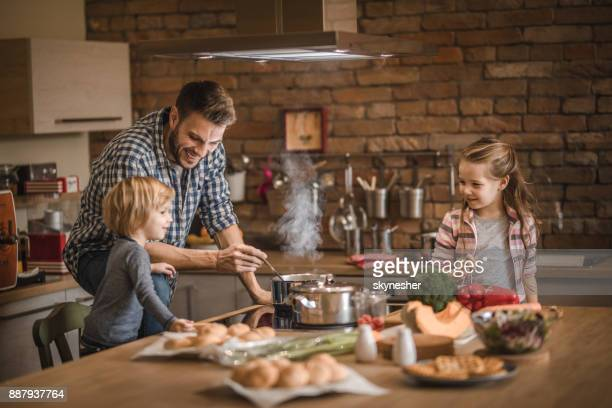 the cutest assistance in the kitchen! - evening meal stock pictures, royalty-free photos & images