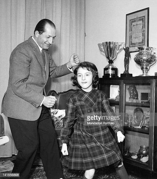 The cyclist Gino Bartali dancing the twist with his daughter Bianca Maria. Florence, March 1963