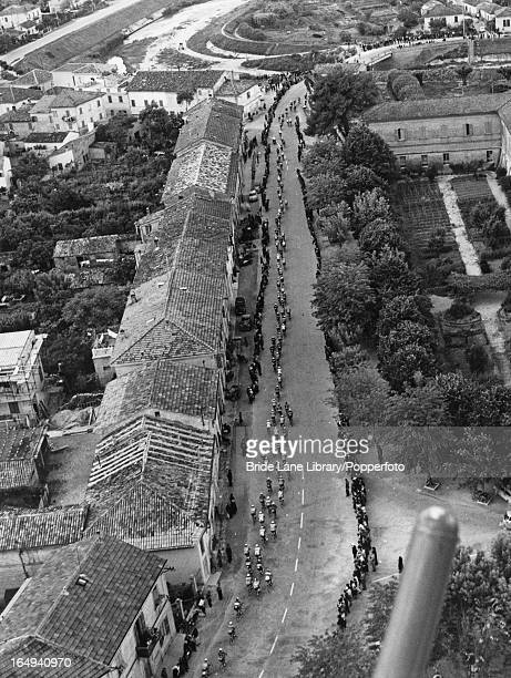 The cyclists pass through a small town in the Arno valley during the Tour of Italy 4th June 1961 This lap is between Ancona and Florence