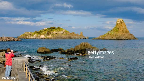 the cyclopean isles, lying off the coast of aci trezza in the mediterranean sea (sicily, italy) - stack rock stock pictures, royalty-free photos & images