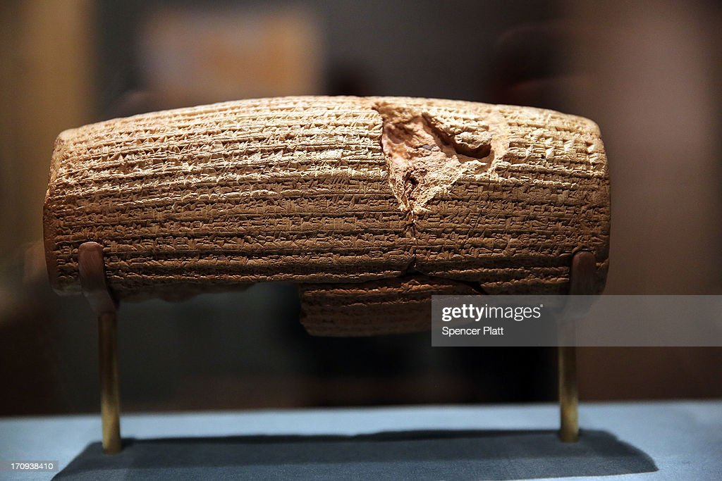 The Cyrus Cylinder-a 2,600-year-old inscribed clay document from Babylon in ancient Iraq-is viewed at the The Metropolitan Museum of Art on June 20, 2013 in New York City. One of the most famous surviving icons from the ancient world, the Cyrus Cylinder is the centerpiece of the traveling exhibition The Cyrus Cylinder and Ancient Persia: Charting a New Empire.