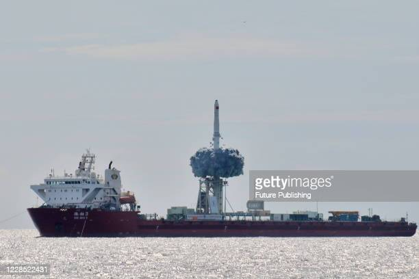 The CZ-11 rocket, carrying nine satellites, rises from a ship in the Yellow Sea in east China's Shandong province Tuesday, Sept. 15, 2020. It is...
