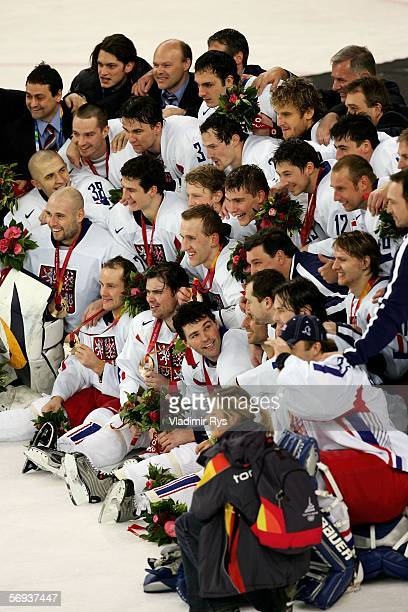 The Czech Republic hockey team poses with the bronze medal after their 30 win against Russia during Day 15 of the Turin 2006 Winter Olympic Games on...