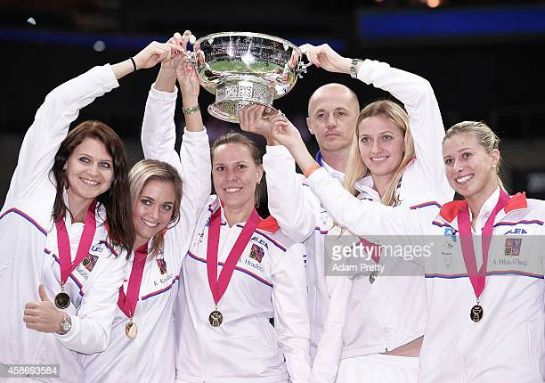 The Czech Republic team including Petr Pala Team Captain Petra Kvitova Lucie Safarova Andrea Hlavackova Lucie Hradecka and Klara Koukalova celebrate...