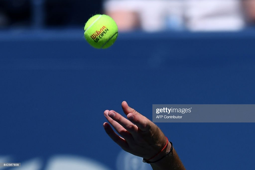 The Czech Republic's Karolina Pliskova serves the ball to Jennifer Brady of the US during their 2017 US Open Women's Singles Round 4 match at the USTA Billie Jean King National Tennis Center in New York on September 4, 2017 Pliskova won the match 6-1, 6-0. / AFP PHOTO / Jewel SAMAD