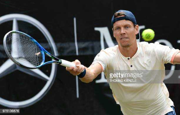 The Czech Republic's Tomas Berdych returns the ball to Canada's Milos Raonic in their quarterfinal match at the ATP Mercedes Cup tennis tournament in...