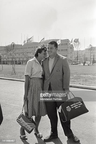 The Czechoslovakian discus thrower Olga Fikotova posing smiling with her husband the American hammer thrower Harold Connolly during Rome Olympics...
