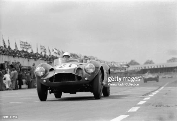 The Daily Express International Trophy Silverstone May 5 1956 Stirling Moss flat out past the pits approaching Copse Corner in the works Aston Martin...
