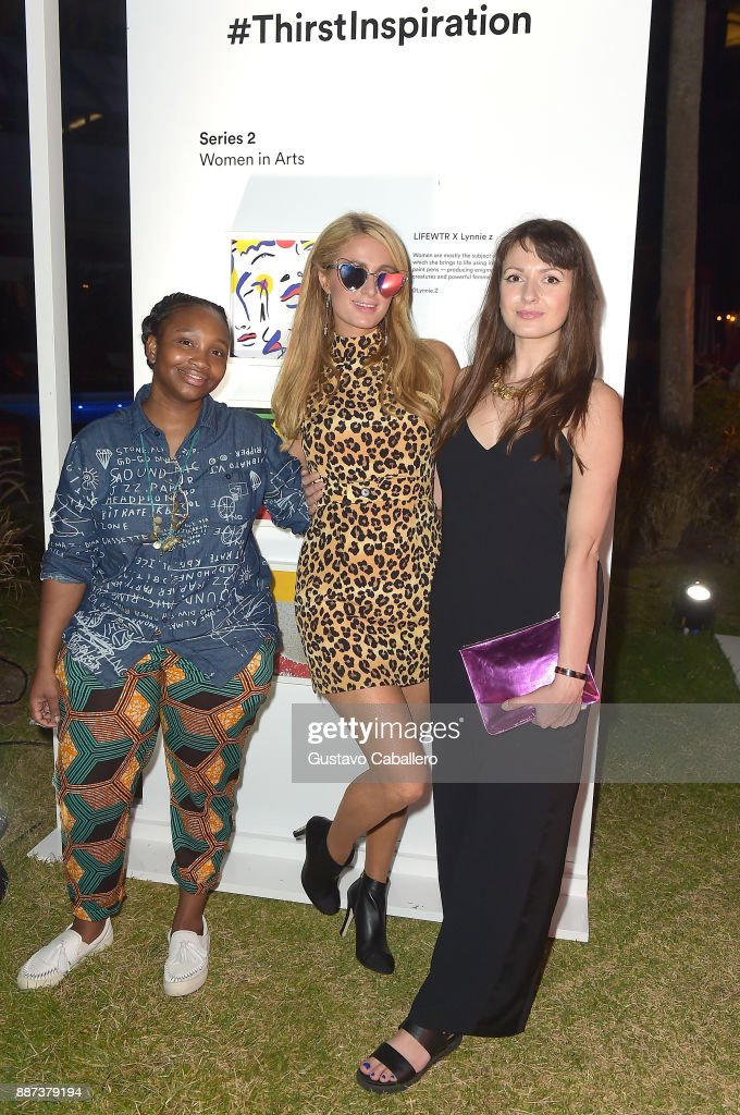 The Daily Front Row celebrates the Launch of Act1 with Adrienne Gaither (L), Paris Hilton and Lynnie Z presented by LIFEWTR at Faena Hotel on December 6, 2017 in Miami Beach, Florida.