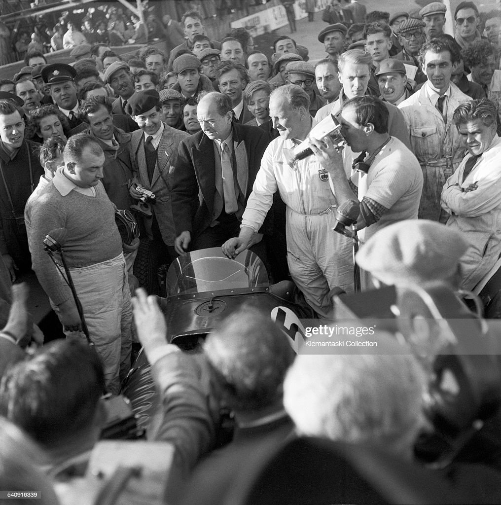 The Daily Graphic Formula Libre Race; Goodwood, September 27, 1952. In some ways this was the high water mark for B.R.M. with their three cars in the first three positions. José Froilán González won, followed by Reg Parnell (the sun shining on him here) and Ken Wharton, drinking from the trophy.