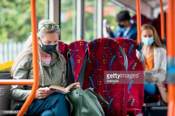 the daily routine during covid 19 - protective face mask stock pictures, royalty-free photos & images