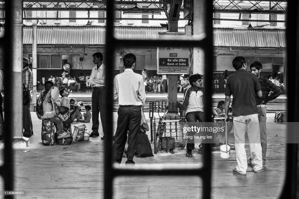 The daily routine of the New Delhi Railway Station platform. : Stock Photo