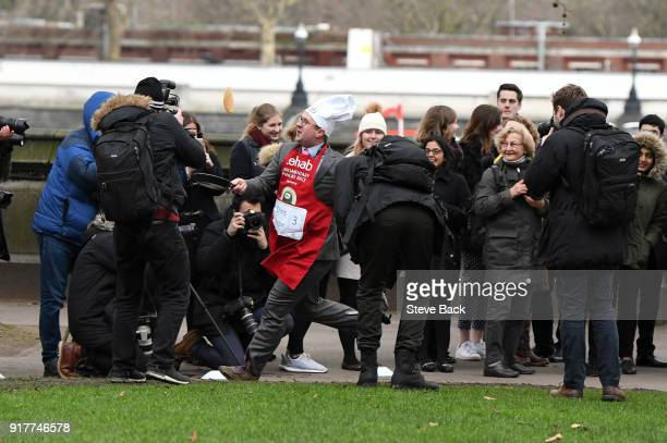 The Daily Telegraph's Political Editor Chris Hope approaches the first corner in the annual Parliamentary Pancake Race in Victoria Tower Gardens on...