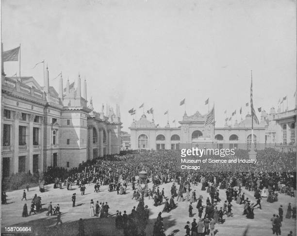 The daily tide of visitors at the World's Columbian Exposition in Chicago Illinois 1893 This image was published in the 'Portfolio of Photographs of...