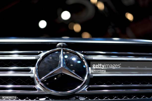 The Daimler AG MercedesBenz logo is seen on the grille of a G 500 vehicle during the 2018 North American International Auto Show in Detroit Michigan...