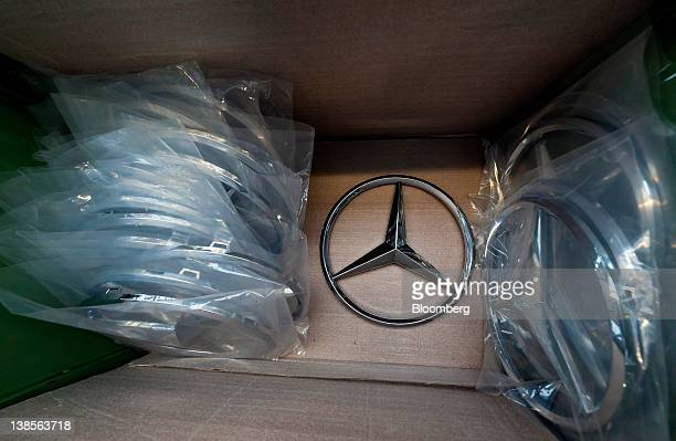 The Daimler AG MercedesBenz logo sits in a box on the production line at the MercedesBenz plant in Woerth Germany on Wednesday Feb 8 2012 Daimler AG...