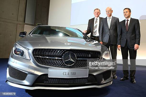 The Daimler Board of Directors Andreas Renschler Bodo Uebber and CEO of Daimler AG Dieter Zetsche are seen during the company's financial performance...