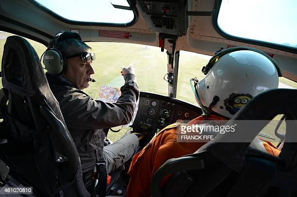 The Dakar Rally director Etienne Lavigne flies in a helicopter to reach the start of the 2015 Dakar Rally stage 1 between Buenos Aires and Villa...