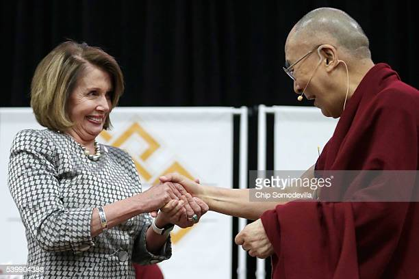 The Dalai Lama and House Minority Leader Nancy Pelosi greet one another before he addresses followers and supporters during an event at the Bender...