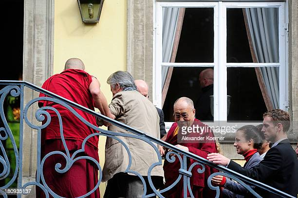 The Dalai Lama arrives prior to a press conference on September 18 2013 in Hanover Germany Today the Dalai Lama is due to give a public talk on...