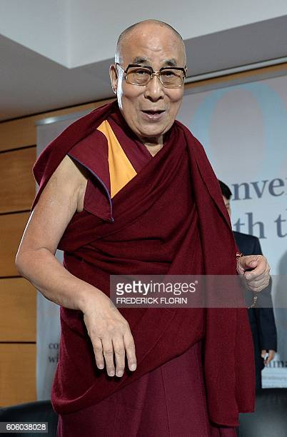 The Dalai Lama arrives to take part in a dialogue with scientists at the University of Strasbourg eastern France on September 16 2016 The Dalai Lama...