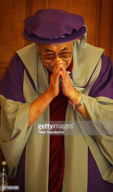 The Dalai Lama bows after receiving an Honorary Doctorate from the London Metropolitan University on May 20 2008 in London The Dalai Lama is visiting...