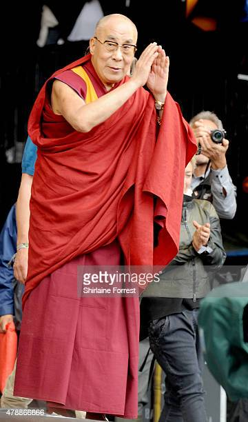 The Dalai Lama celebrates his 80th Birthday with Patti Smith on The Pyramid Stage at the Glastonbury Festival at Worthy Farm Pilton on June 28 2015...