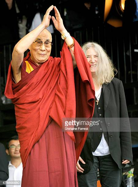 The Dalai Lama celebrates his 80th Birthday with Patti Smith on The Pyramid Stage at the Glastonbury Festival at Worthy Farm Pilton on June 28 2015...