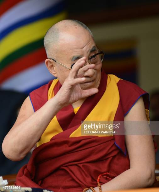 The Dalai Lama gestures at an event to mark his 80th birthday at Tsuglakhang temple in McLeod Ganj on June 21 2015 The Dalai Lama marked his official...