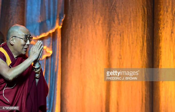The Dalai Lama gestures on arrival at the Honda Center in Anaheim California on July 5 where the religious leader celebrated his 80th birthday with a...