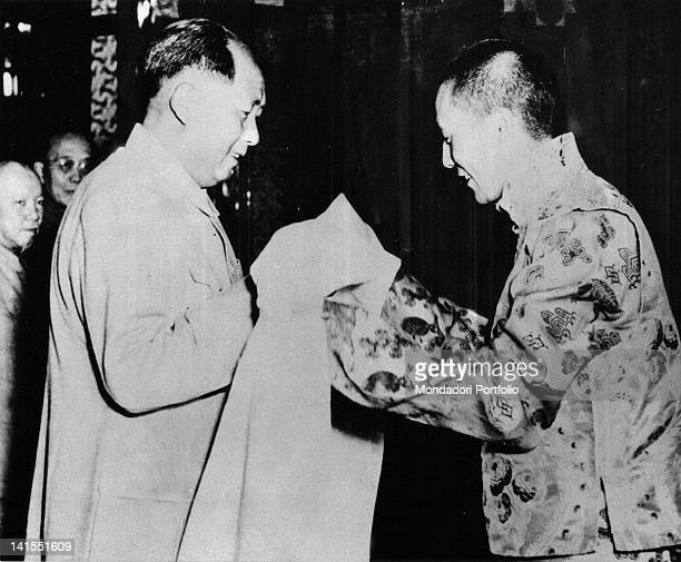 The Dalai Lama giving a white silk scarf to the Chinese President Mao Zedong Beijing 1954