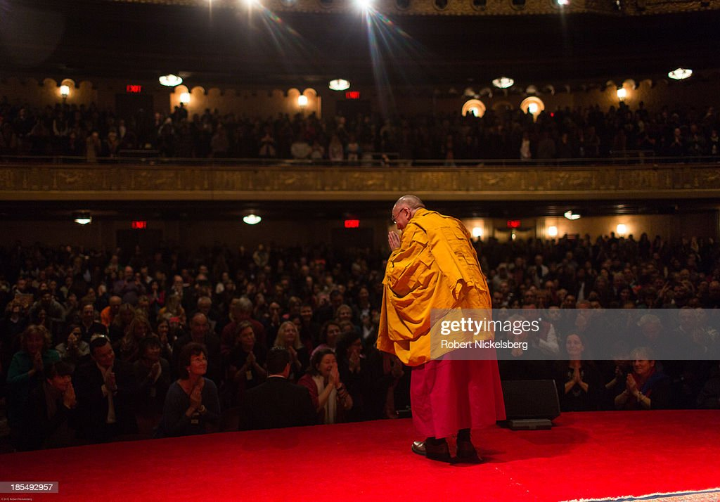 The Dalai Lama greets the audience during an initiation ceremony at the Beacon Theater October 20, 2013 in New York City. The Dalai Lama is in New York City for three days of his Buddhist teachings that run October 18-20. The teachings are supported by the Richard Gere Foundation.