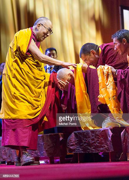 The Dalai Lama greets Tibetan monks before his speech on the second day of his threeday visit on 11 May 2014 in Rotterdam Netherlands