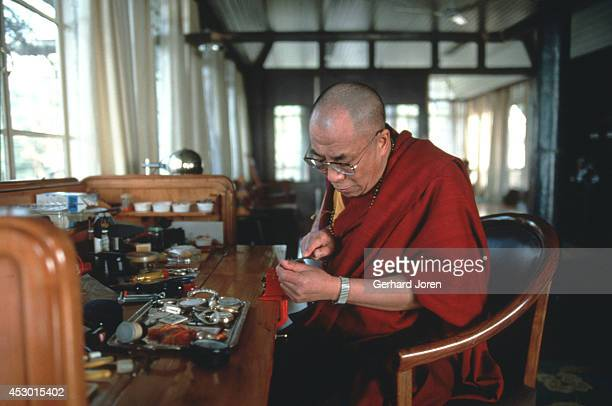 The Dalai Lama in action with his only hobby repairing watches at his residence in McLeod Ganj He still has a Rolex watch given to him by late US...
