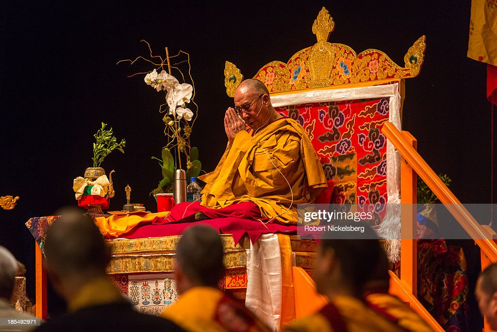 The Dalai Lama prays during an initiation ceremony at the Beacon Theater October 20, 2013 in New York City. The Dalai Lama is in New York City for three days of his Buddhist teachings that run October 18-20. The teachings are supported by the Richard Gere Foundation.
