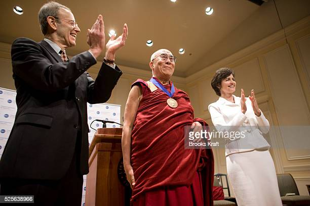 The Dalai Lama receives the National Endowment for Democracy's Democracy Service Medal during a ceremony at the Library of Congress in Washington...