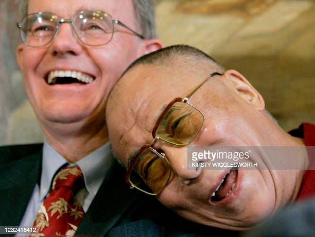 The Dalai Lama shares a joke with British Member of Parliament Chris Mullin during a press conference in Westminster, London, on May 21, 2008. The...