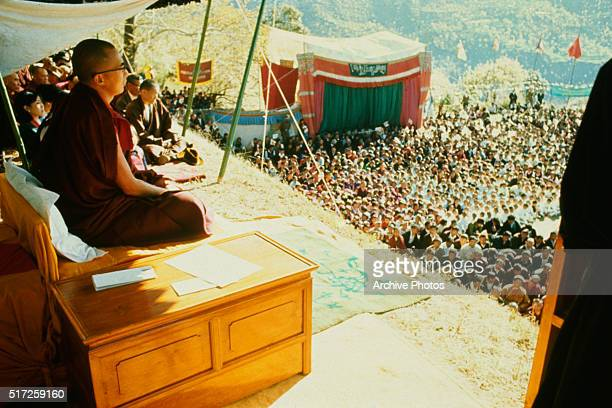 The Dalai Lama sits before his followers at a mammoth ceremony celebrating the 10th anniversary of the Tibetan uprising against the Chinese Communists