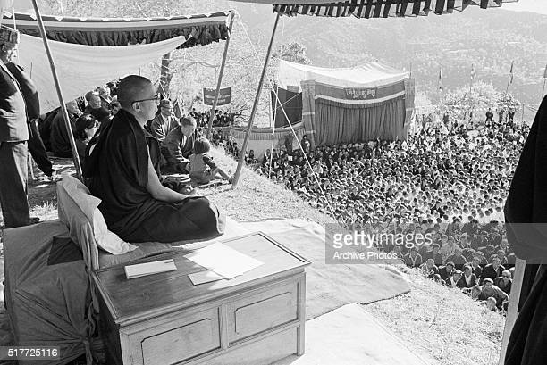 The Dalai Lama sits before his followers at a mammoth ceremony celebrating the 10th anniversary of the Tibetan uprising against the Chinese...
